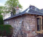House extension with stone wall cladding