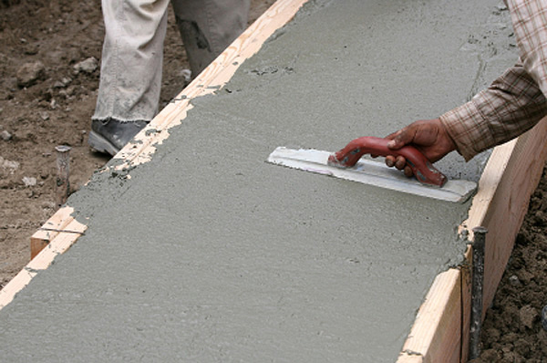 smoothing a concrete in the foundation formwork